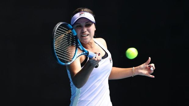 MELBOURNE, AUSTRALIA - FEBRUARY 11: Sofia Kenin of the United States of America plays a forehand in her Women's Singles second round match against Kaia Kanepi of Estonia during day four of the 2021 Australian Open at Melbourne Park on February 11, 2021 in Melbourne, Australia. (Photo by Darrian Traynor/Getty Images)