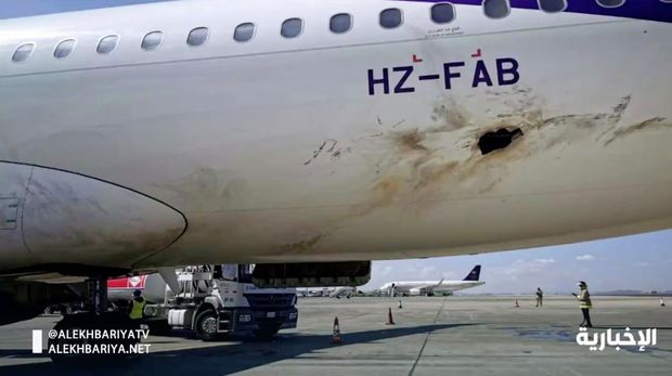 In this frame grab from video, Saudi state television shows an airplane damaged in an attack by Yemen's Houthi rebels at an airport near Abha, Saudi Arabia, Wednesday, Feb. 10, 2021. Yemen's Houthi rebels targeted the airport in southwestern Saudi Arabia, causing a civilian plane on the tarmac to catch fire, the kingdom's state television reported, an attack that threatens to escalate Yemen's grinding war. Authorities initially suspected the attack was carried out by a drone. (Saudi state television via AP)