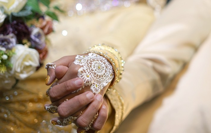 Close up Bride and groom hand in hand, Indonesian Wedding Tradition Ceremony