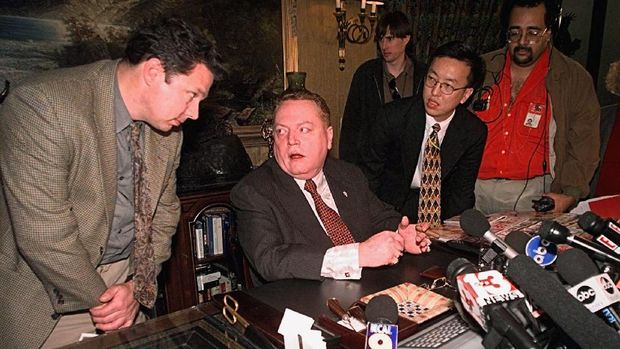 Larry Flynt, Hustler magazine publisher, is surrounded by reporters Friday, Dec. 18, 1998 Los Angeles.  Flynt claimed Friday he has gathered evidence showing that Rep. Bob Livingston has had possibly a dozen extramarital affairs within the past 10 years.   Flynt said Livingston's admission of adultery was prompted by Flynt's discoveries. (AP Photo/Kevork Djansezian)