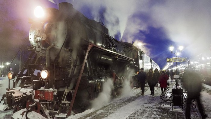A Soviet era steam locomotive pulls a retro train from the city of Sortavala about 200 km (125 miles) north of St.Petersburg, Russia, Wednesday, Feb. 17, 2021. The steam-powered retro train runs daily in Karelia, a Russian region on the border with Finland, taking tourists to the Ruskeala natural park from the city of Sortavala. (AP Photo/Dmitri Lovetsky)