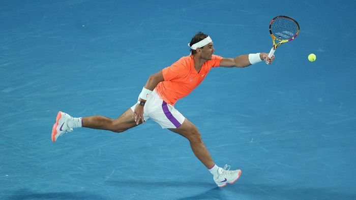MELBOURNE, AUSTRALIA - FEBRUARY 17:  Rafael Nadal of Spain  plays a forehand during his Men's Singles Quarterfinals match against Stefanos Tsitsipas of Greece during day 10 of the 2021 Australian Open at Melbourne Park on February 17, 2021 in Melbourne, Australia. (Photo by Matt King/Getty Images)
