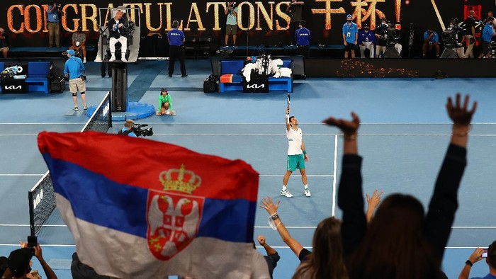 MELBOURNE, AUSTRALIA - FEBRUARY 18:  Novak Djokovic of Serbia waves to the crowd following victory in his Men's Singles Semifinals match against Aslan Karatsev of Russia during day 11 of the 2021 Australian Open at Melbourne Park on February 18, 2021 in Melbourne, Australia. (Photo by Cameron Spencer/Getty Images)