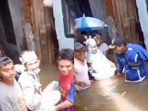 Viral pengantin wanita pakai bak mandi bayi saat banjir.