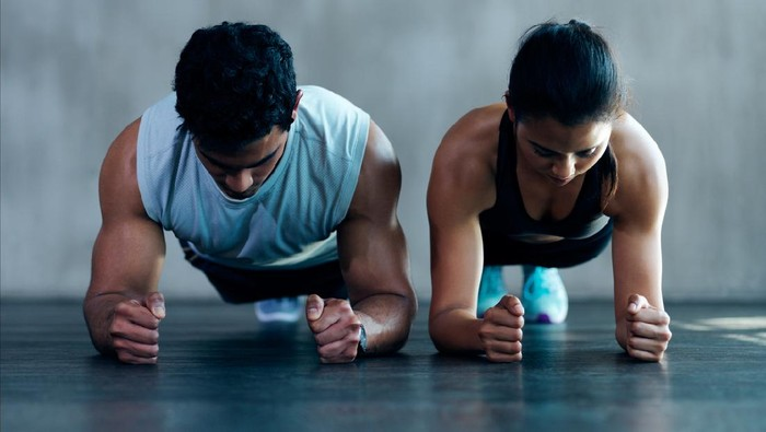 Shot of an attractive young couple working out together at the gym