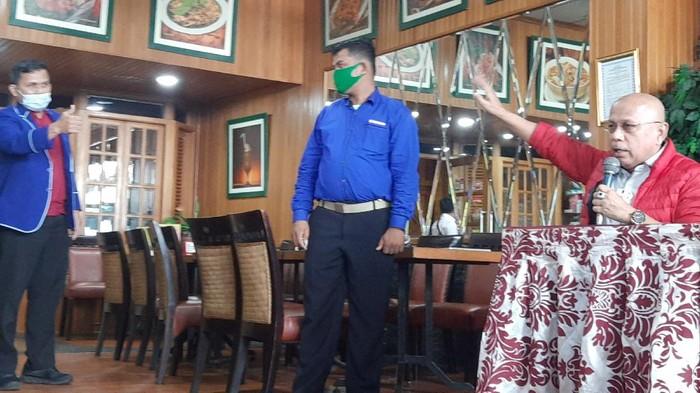 Satgas Rajawali PD datangai konferensi pers Kader Muda Demokrat.