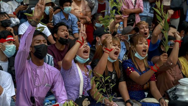 Hundreds of anti-coup protesters march in Yangon, Myanmar, Thursday, Feb. 25, 2021. Social media giant Facebook announced Thursday it was banning all accounts linked to Myanmar's military as well as ads from military-controlled companies in the wake of the army's seizure of power on Feb. 1. (AP Photo)