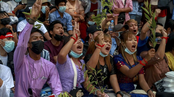 Hundreds of anti-coup protesters march in Yangon, Myanmar, Thursday, Feb. 25, 2021. Social media giant Facebook announced Thursday it was banning all accounts linked to Myanmars military as well as ads from military-controlled companies in the wake of the armys seizure of power on Feb. 1. (AP Photo)