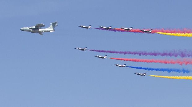 A KJ-2000 airborne early warning and control system plane leads J-10 fighter jets as they fly in formation during a parade commemorating the 70th anniversary of Japan's surrender during World War II in Beijing, Thursday, Sept. 3, 2015. The spectacle involved more than 12,000 troops, 500 pieces of military hardware and 200 aircraft of various types, representing what military officials say is the Chinese military's most cutting-edge technology. (AP Photo/Mark Schiefelbein)