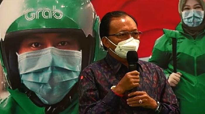 Tangkapan layar Gubernur Bali Wayan Koster saat peresmian program vaksin drive thru bersama Menkes Budi Sadikin di Bali Nusa Dua Convention Center (BNDCC), Kawasan Pariwisata Nusa Dua, Badung, Minggu (28/2/2021)