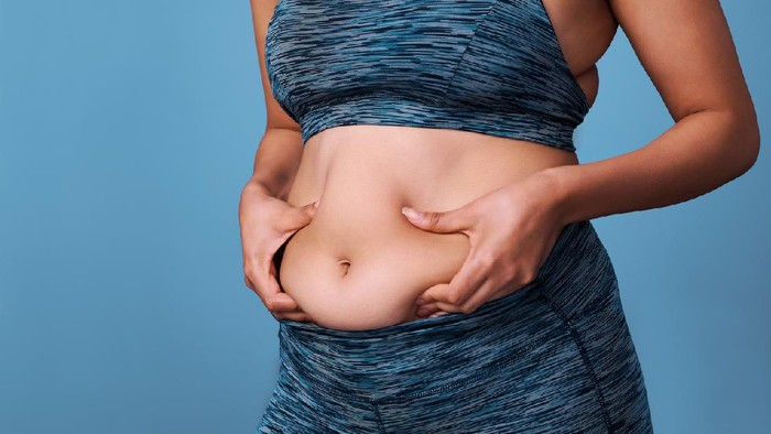 Cropped shot of an unrecognizable woman struggling with weight issues