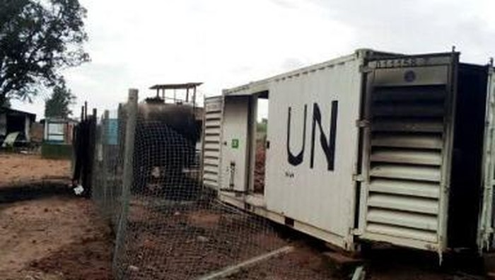 Burnt containers are seen at the United Nations (UN) civil base in Beni in the eastern part of the Democratic Republic of Congo on November 26, 2019. - On November 25, 2019 angry demonstrators ransacked and looted the UN civil base in Beni. At least four demonstrators were killed in Beni on November 25, 2019, in demonstrations against the slaughter of dozens of civilians by armed groups in the region. (Photo by ALBERT KAMBALE / AFP)