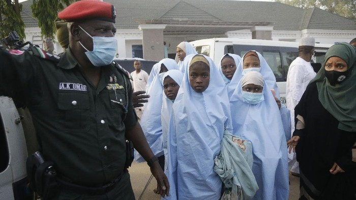 Some of the students who were abducted by gunmen from the Government Girls Secondary School, in Jangebe, last week wait for a medical checkup after their release meeting with the state Governor Bello Matawalle, in Gusau, northern Nigeria, Tuesday, March 2, 2021. Zamfara state governor Bello Matawalle announced that 279 girls who were abducted last week from a boarding school in the northwestern Zamfara state have been released Tuesday.(AP Photo/Sunday Alamba)