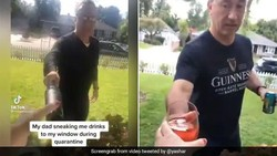 Kocak! Aksi Pria saat Berikan Minuman untuk Putrinya yang Terpapar COVID-19
