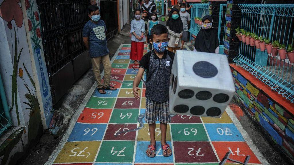 Cegah Anak Kecanduan Gadget Lewat Mural Permainan Tradisional