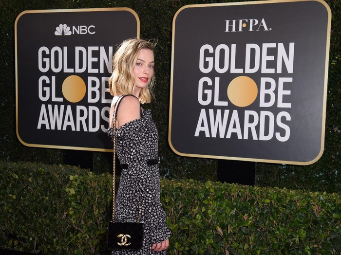 Margot Robbie arrives at the 78th Annual Golden Globe Awards at the Beverly Hilton in Beverly Hills, CA on Sunday, February 28, 2021.