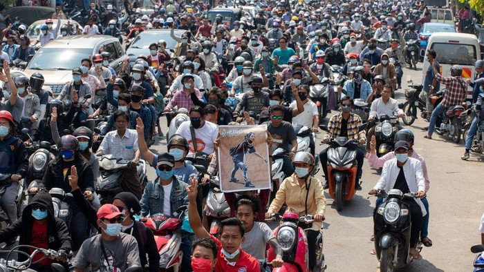 People attend the funeral procession for protester Kyal Sin, in Mandalay on March 4, 2021, a day after she was shot in the head while taking part in a demonstration against the military coup. (Photo by STR / AFP)