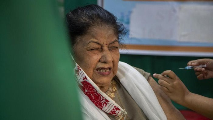 An elderly woman receives the COVID-19 vaccine at a private hospital in Gauhati, India, Thursday, March 4, 2021. The COVID-19 vaccination drive for senior citizens and those above 45 years of age with comorbidities began in government and designated private hospitals in Gujarat on Monday along with the rest of the country. (AP Photo/Anupam Nath)