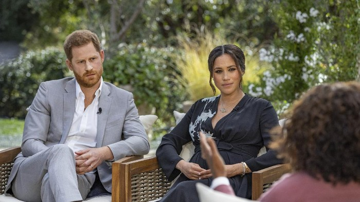 This image provided by Harpo Productions shows Meghan, The Duchess of Sussex, left, in conversation with Oprah Winfrey. (Joe Pugliese/Harpo Productions via AP)