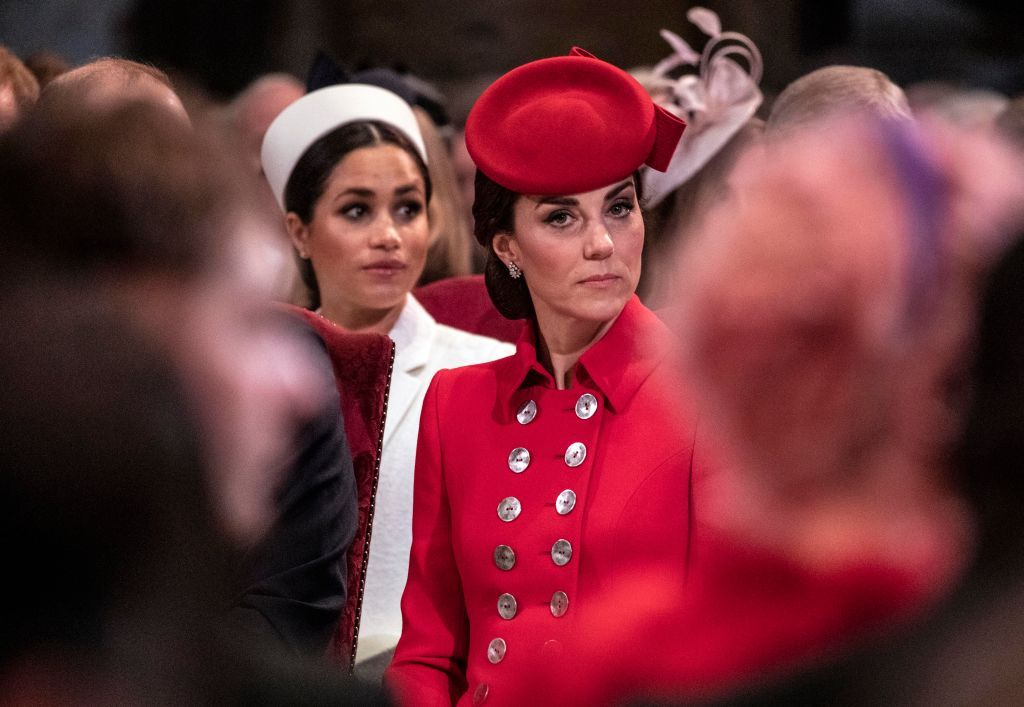 LONDON, ENGLAND - MARCH 11: Catherine, The Duchess of Cambridge sits near Meghan, Duchess of Sussex as they attend the Westminster Abbey Commonwealth day service on March 11, 2019 in London, England. Commonwealth Day has a special significance this year, as 2019 marks the 70th anniversary of the modern Commonwealth, with old ties and new links enabling cooperation towards social, political and economic development which is both inclusive and sustainable. The Commonwealth represents a global network of 53 countries and almost 2.4 billion people, a third of the worlds population, of whom 60 percent are under 30 years old. Each year the Commonwealth adopts a theme upon which the Service is based. This years theme A Connected Commonwealth speaks of the practical value and global engagement made possible as a result of cooperation between the culturally diverse and widely dispersed family of nations, who work together in friendship and goodwill. The Commonwealths governments, institutions and people connect at many levels, including through parliaments and universities. They work together to protect the natural environment and the ocean which connects many Commonwealth nations, shore to shore. Cooperation on trade encourages inclusive economic empowerment for all people - particularly women, youth and marginalised communities. The Commonwealths friendly sporting rivalry encourages people to participate in sport for development and peace. (Photo by Richard Pohle - WPA Pool/Getty Images)