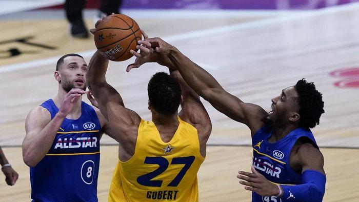 Utah Jazz guard Donovan Mitchell blocks a shot by Utah Jazz center Rudy Gobert during the second half of basketballs NBA All-Star Game in Atlanta, Sunday, March 7, 2021. (AP Photo/Brynn Anderson)