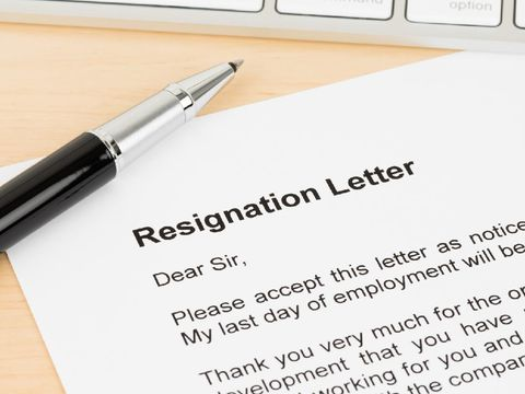 Resignation letter resign with pen and keyboard