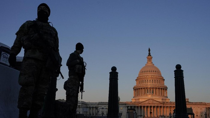 National Guard stand their posts around the Capitol at sunrise in Washington, Monday, March 8, 2021. (AP Photo/Carolyn Kaster)