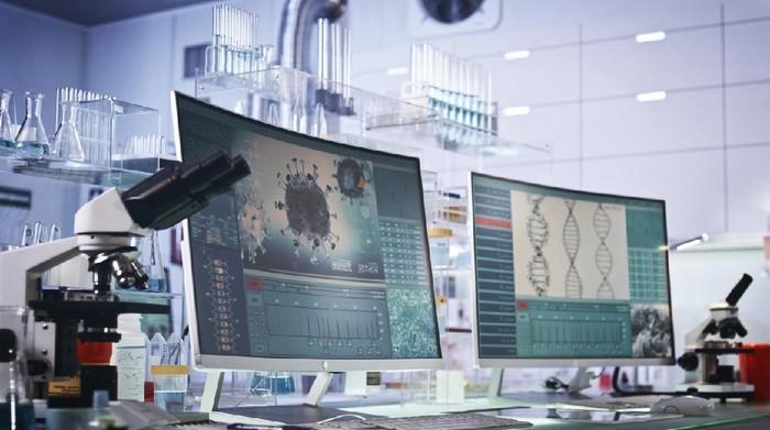Modern laboratory interior. Coronavirus research. Word Covid-19 on the screen