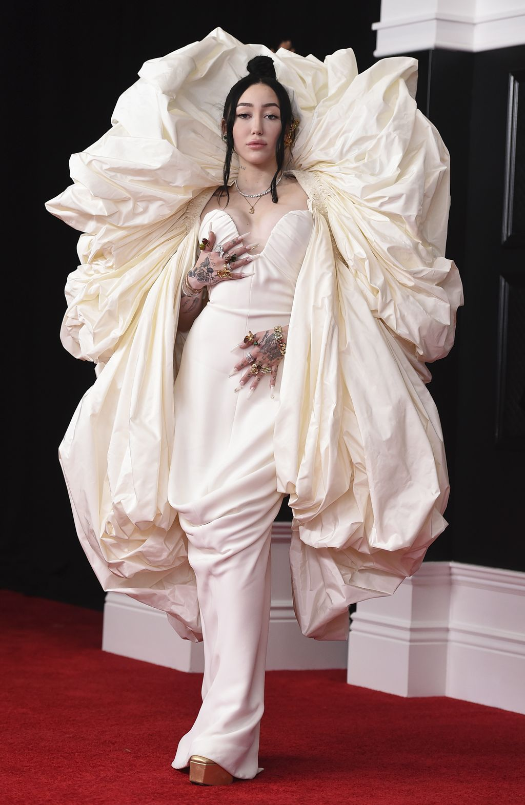 Noah Cyrus arrives at the 63rd annual Grammy Awards at the Los Angeles Convention Center on Sunday, March 14, 2021. (Photo by Jordan Strauss/Invision/AP)