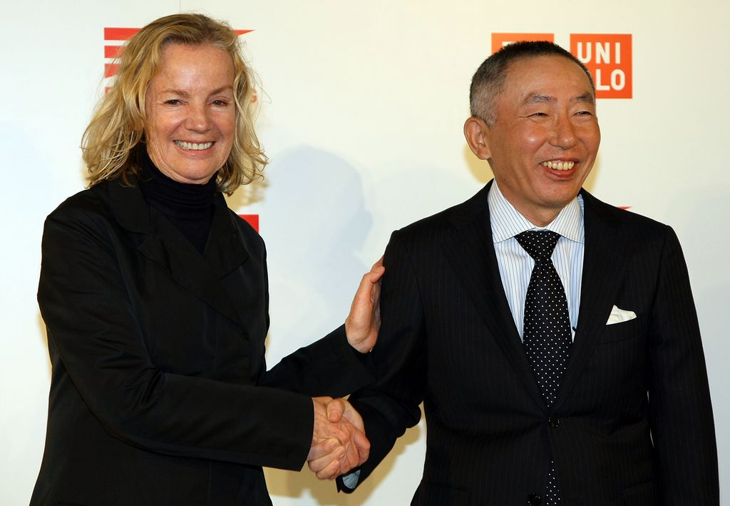 TOKYO - MARCH 17:  Designer Jil Sander (L) and Tadashi Yanai (R), Chairman and CEO, Fast Retailing Co., Ltd. pose for photographs during a press conference at Four Seasons Hotel Chinzanso on March 17, 2009 in Tokyo, Japan. Sander closes the design consultation contract with Uniqlo band, a Japanese casual wear retail chain owned and developed by Fast Reailing. New products supervised by Sander will be on sale from Autumn 2009.  (Photo by Junko Kimura/Getty Images)