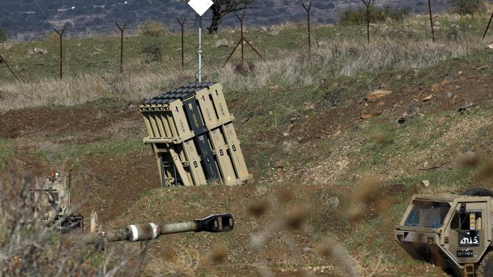 A battery of Israels Iron Dome, designed to intercept and destroy incoming short-range rockets and artillery shells, is pictured in the Israeli-annexed Golan Heights near the border with Syria, on November 18, 2020. - Israeli warplanes struck Syria Wednesday, hitting Iranian targets and killing 10 Syrian and foreign fighters in what the Israeli army called a retaliatory attack after explosive devices were found near one of its bases on the occupied Golan Heights. (Photo by JALAA MAREY / AFP)