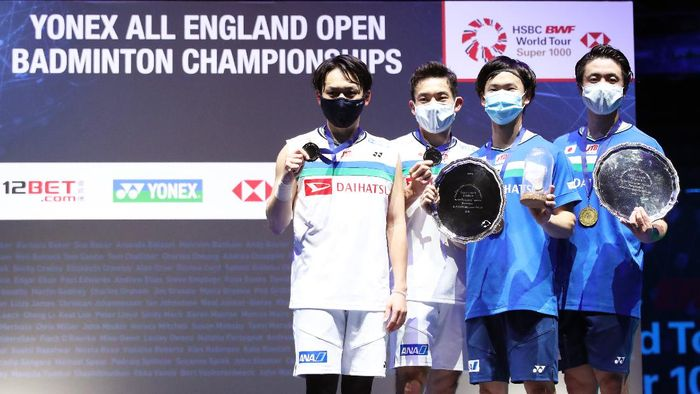 BIRMINGHAM, ENGLAND - MARCH 21: Yuta Watanabe and Hiroyuki Endo pose with the trophy after their victory in the Mens Double final with Takeshi Kamura and Keigo Sonoda of Japan during day five of YONEX All England Open Badminton Championships at Utilita Arena Birmingham on March 21, 2021 in Birmingham, England. (Photo by Naomi Baker/Getty Images)