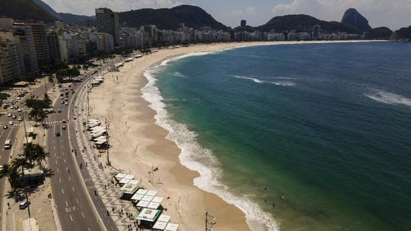 Dikutip dari Reuters, Kementerian Kesehatan Brasil melaporkan 90.570 kasus terinfeksi Corona pada Jumat (19/3), dan rekor harian dalam 24 jam. AP Photo/Lucas Dumphreys