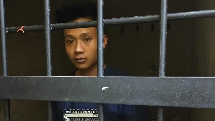 K (25), pria yang diduga memenggal dan mengarak kepala ayahnya keliling kampung di Lampung.