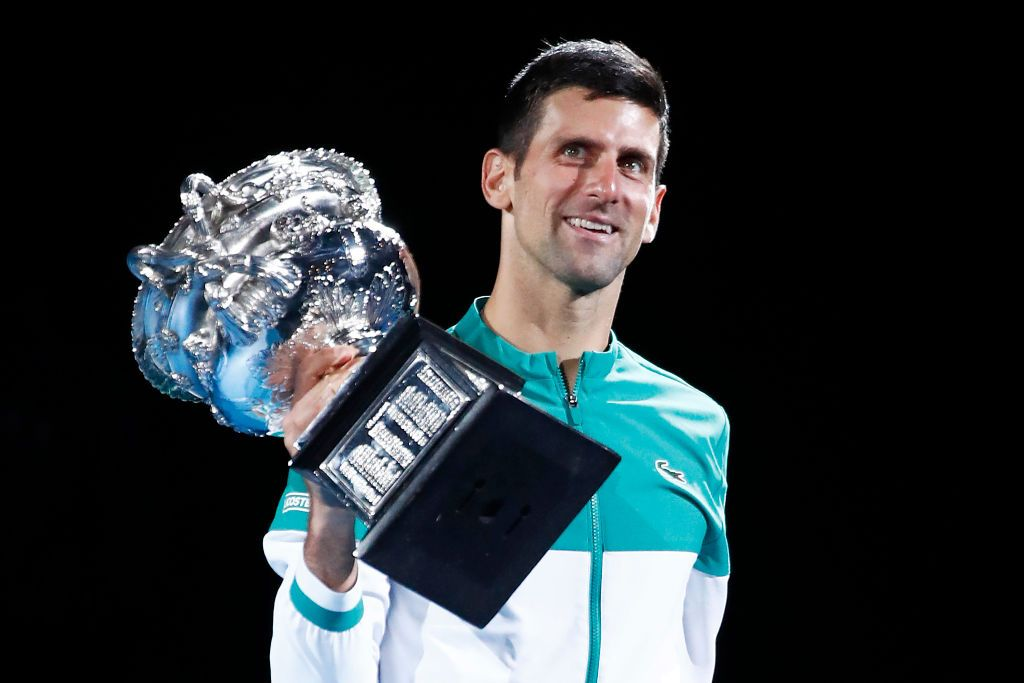 MELBOURNE, AUSTRALIA - FEBRUARY 21: Novak Djokovic of Serbia kisses the Norman Brookes Challenge Cup as he celebrates victory in his Men's Singles Final match against Daniil Medvedev of Russia during day 14 of the 2021 Australian Open at Melbourne Park on February 21, 2021 in Melbourne, Australia. (Photo by Daniel Pockett/Getty Images)