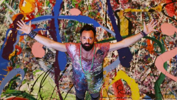 DUBAI, UNITED ARAB EMIRATES - SEPTEMBER 09: Artist Sacha Jafri works on his canvas