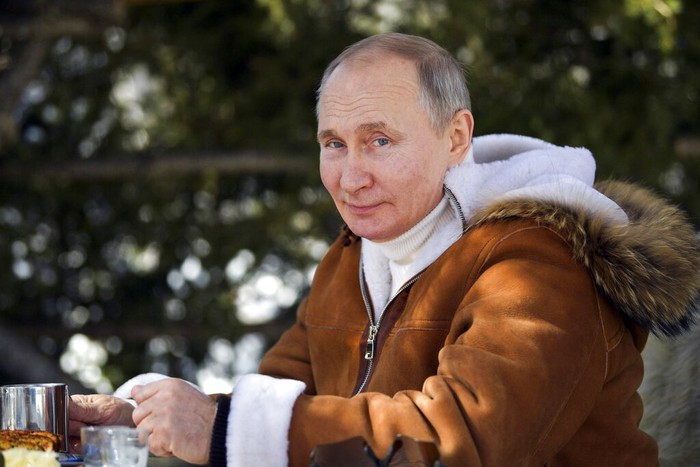 In this photo made available on Sunday, March 21, 2021, Russian President Vladimir Putin poses for a photo in a taiga forest in Russias Siberian region. Putin and Russia Defense Minister Sergei Shoigu are spending the weekend in Siberia said Kremlin spokesman Dmitry Peskov. (Alexei Druzhinin, Sputnik, Kremlin Pool Photo via AP)