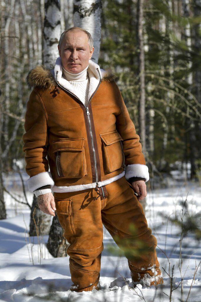 In this photo made available on Sunday, March 21, 2021, Russian President Vladimir Putin poses for a photo in a taiga forest in Russia's Siberian region. Putin and Russia Defense Minister Sergei Shoigu are spending the weekend in Siberia said Kremlin spokesman Dmitry Peskov. (Alexei Druzhinin, Sputnik, Kremlin Pool Photo via AP)