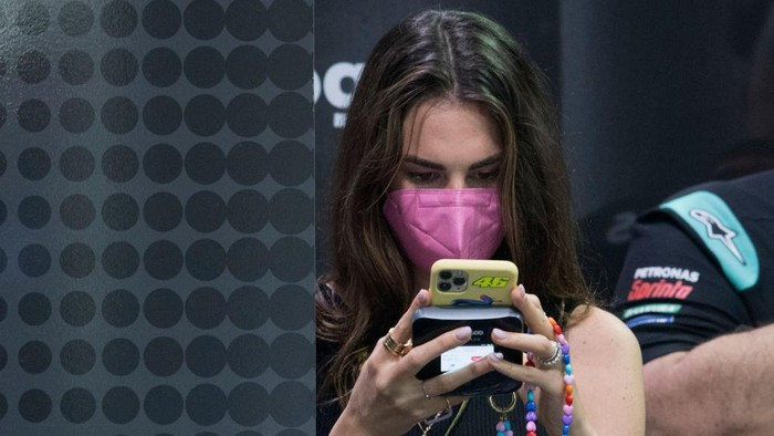 DOHA, QATAR - MARCH 26: Francesca Sofia Novello of Italy (girlfriend of Valentino Rossi of Italy and Petronas Yamaha SRT ) on her mobile phone in box during the MotoGP of Qatar - Free Practice at Losail Circuit on March 26, 2021 in Doha, Qatar. (Photo by Mirco Lazzari gp/Getty Images)
