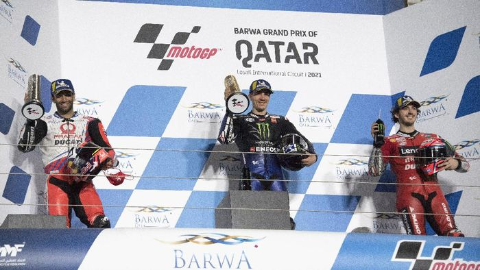 DOHA, QATAR - MARCH 28:  (L-R)  Johann Zarco of France and Pramac Racing, Maverick Vinales of Spain and Monster Energy Yamaha MotoGP Team and Francesco Bagnaia of Italy and Ducati Lenovo Team celebrate on the podium at the end of the MotoGP race during the MotoGP of Qatar - Race at Losail Circuit on March 28, 2021 in Doha, Qatar. (Photo by Mirco Lazzari gp/Getty Images)
