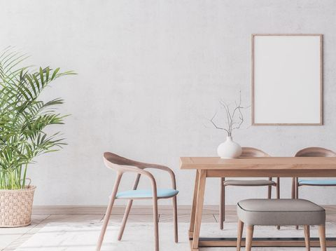 Wooden chairs and table on gray  background, rattan pot and trendy home accessories , Scandinavian dining room interior design with empty wooden frame template.