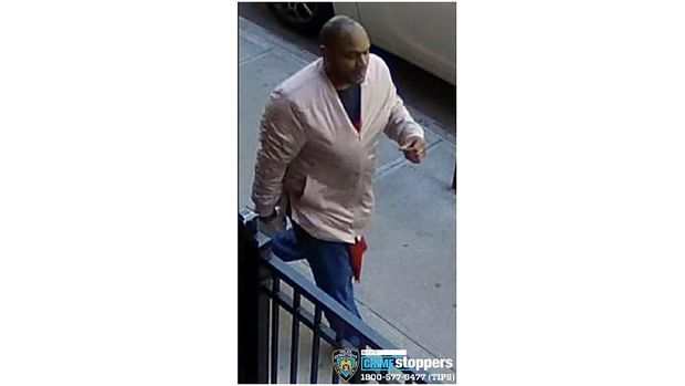 This image taken from surveillance video provided by the New York City Police Department shows a person of interest in connection with an assault of an Asian American woman, Monday, March 29, 2021, in New York. The NYPD is asking for the public's assistance in identifying the man. (Courtesy of New York Police Department via AP)