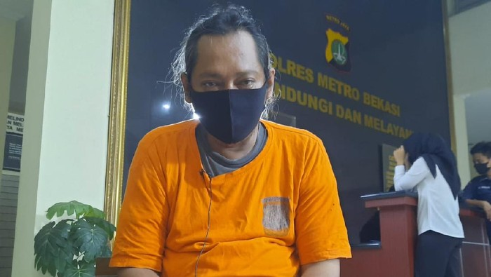 Herman alias Hermawan alias Ustaz Gondrong tersangka penipuan penggandaan uang.