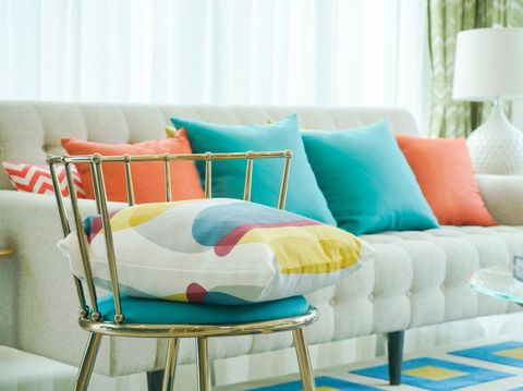 Closeup pillow on vintage chair with sofa in living room