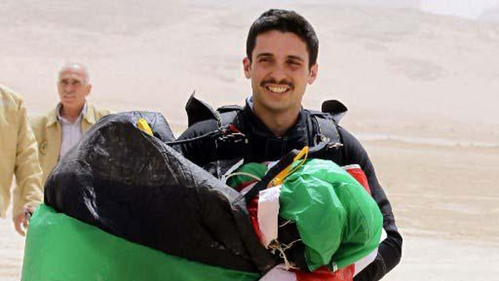 Jordanian Prince Hamzah bin al-Hussein, president of the Royal Aero Sports Club of Jordan, carries a parachute during a media event to announce the launch of
