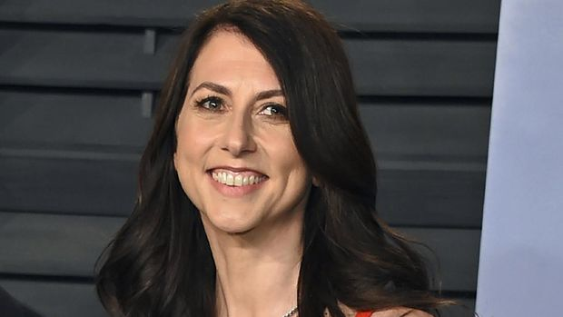 FILE - In this March 4, 2018, file photo, then-MacKenzie Bezos arrives at the Vanity Fair Oscar Party in Beverly Hills, Calif. Scott, philanthropist, author and former wife of Amazon founder Jeff Bezos, has married a Seattle science teacher. Dan Jewett wrote in a letter to the website of the nonprofit organization the Giving Pledge, on Saturday, March 6, 2021, that he was grateful to be able to marry such a generous person and was ready to help her give away her wealth to help others. (Photo by Evan Agostini/Invision/AP, File)