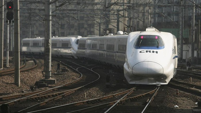 SHANGHAI, CHINA - MAY 11:  (CHINA OUT) A CRH high-speed train leaves Shanghai Hongqiao Railway Station during its test run on May 11, 2011 in Shanghai, China. After 3 years construction, from April in 2008, with total investment estimated at 220.9 billion yuan (around 32.5 billion U.S. dollars), the Beijing-Shanghai high-speed railway begins a one-month trial operation. It is expected to start operation in June this year, with the travel time between the two cities reducing to five hours from the previous 10.