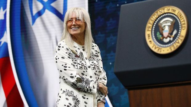Miriam Adelson, wife of Las Vegas Sands Corporation Chief Executive and Republican mega donor Sheldon Adelson, stands onstage before introducing President Donald Trump at the Israeli American Council National Summit in Hollywood, Fla., Saturday, Dec. 7, 2019. (AP Photo/Patrick Semansky)