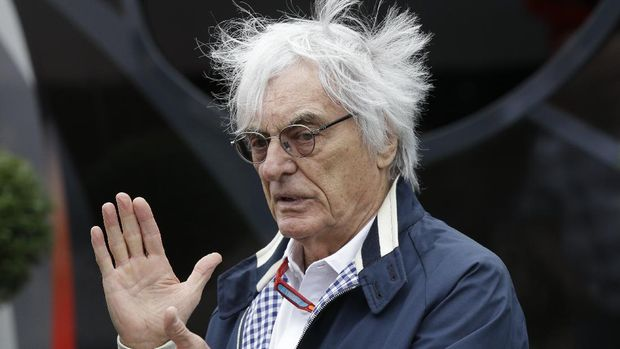 FILE - In this file photo dated Saturday, July 9, 2016, Bernie Ecclestone gestures in a paddock at the Silverstone racetrack, Silverstone, England.   Ecclestone spoke to reporters Friday April 14, 2017, before the Bahrain Grand Prix, about his limited input as adviser to the new owners of F1, Liberty Media. (AP Photo/Luca Bruno, FILE)