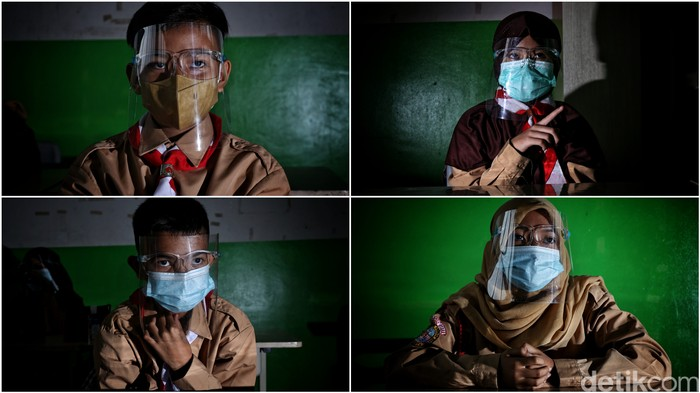 Guru memberikan pelajaran kepada murid saat uji coba belajar tatap muka di kawasan SDN 11 Pademangan Barat, Jakarta Utara, Rabu (7/4). SDN Pademangan Barat 11 memulai uji coba belajar tatap muka bagi siswa kelas V di tengah pandem COVID-19. Protokol kesehatan menjadi hal utama baik bagi siswa maupun tenaga pendidik.